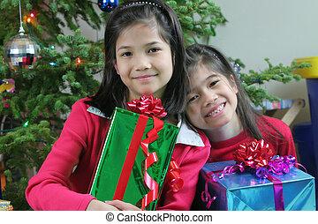 Girls holding presents