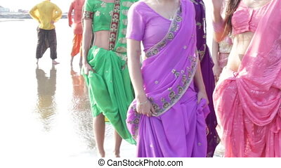 girls in Indian national sari wait for festival event on...