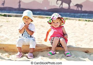 girls in sand