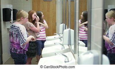 Girls in school restroom / bathroom