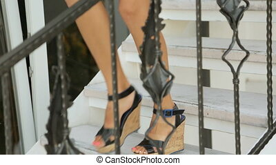 Girls in shoes walking down the stairs