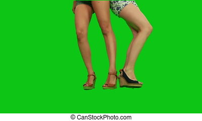 Girls in shorts dancing. We see onl