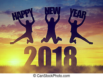 Girls jumps up while celebrating New Year 2018. - Silhouette...