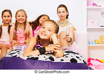 Girls laying and sitting together on big bed - Girls laying...