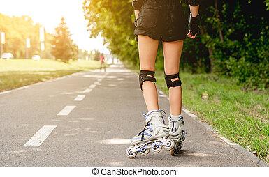 Girls legs in line roller skates