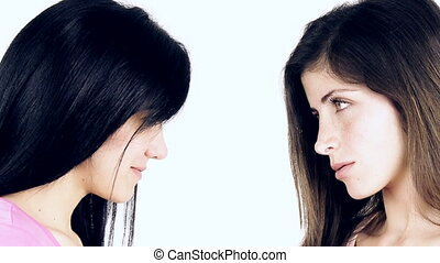 girls looking at each other angry