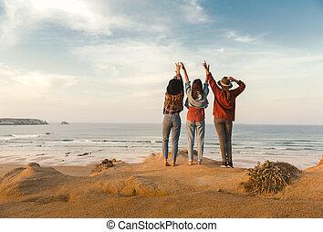Girls looking the ocean