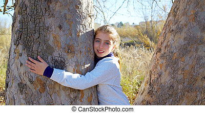 girls loves nature hug a tree tunk