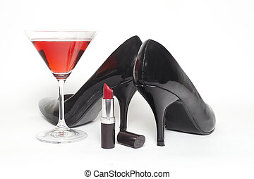 Girls night out concept with shoes, drink and lipstick