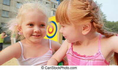 Two little girls on carousel