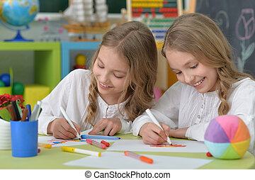 girls on lesson of art - portrait of Cute girls on lesson of...