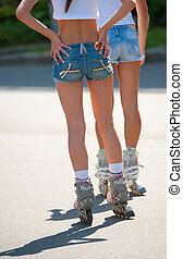 Girls on roller skates
