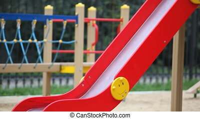 Girls on slide  - Little twin girls sliding down the chute