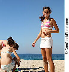 Girls on the beach - Three teen girls playing on the beach