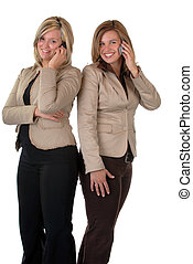 Girls On The Mobile Phone - Two Attractive Young Woman...