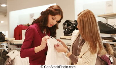 Girls picking shirt