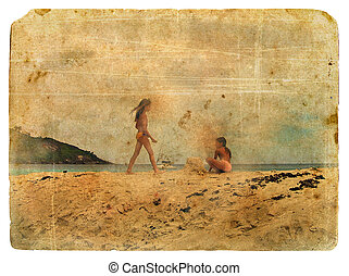 Girls play on the beach. Old postcard.