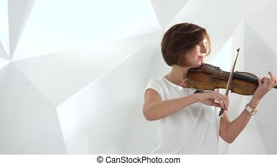 Girls play the violin lyric composition. Close up - Girls...