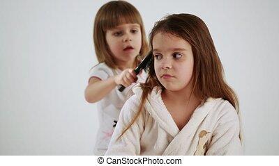 Girls playing hairdresser