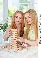 girls  playing table game