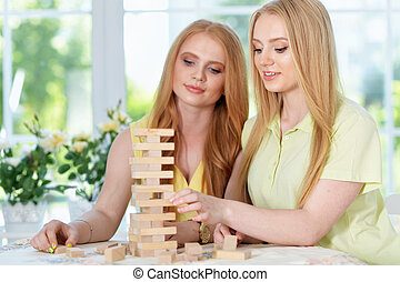 girls  playing table game