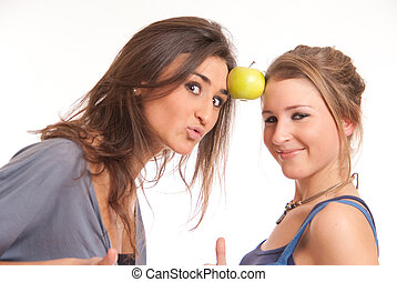 Girls playing the Apple game