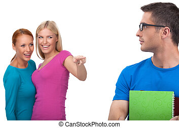 Girls pointing nerd. Two attractive young women laughing at...