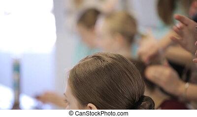 Girls prepare for photoshoot in art studio in makeup room