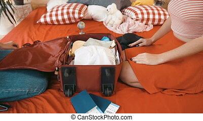 Girls Prepare for Trip