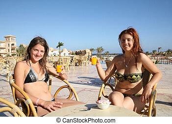 Girls relaxing at resort hotel