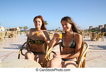 Girls relaxing with orange juice
