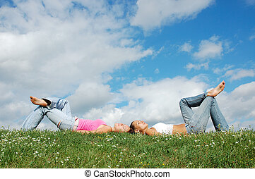 girls resting on the grass