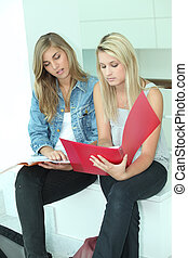 Girls reviewing notes