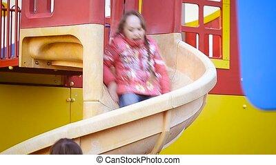 Girls riding a slide