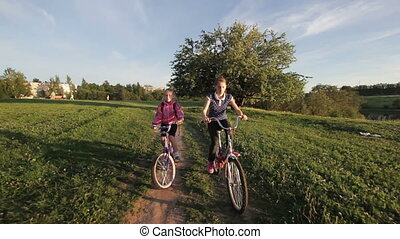 Girls riding bicycle in the countryside
