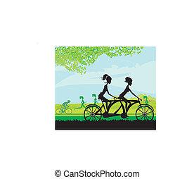 girls riding tandem bicycle