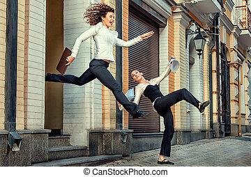 Girls run and rejoice - Girl joyfully ran out of the office...