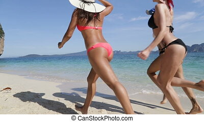 Girls Running Along Beach Back Rear View, Woman Group In Hat...
