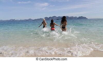 Girls Running In Water Throwing Away Bikini Back Rear View,...