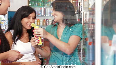 Girls Shopping in Cosmetics Store