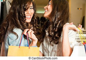 girls shopping laughing