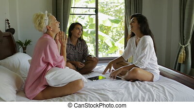 Girls Sit On Bed Talking Morning In Bedroom Laughing, Happy...