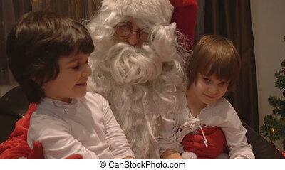 Girls sitting in Santa Claus Lap