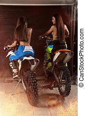 Girls sitting on motorbikes