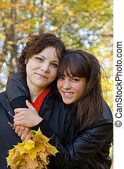 girls standing in autumn