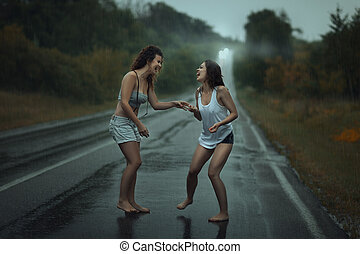 Lesbians kissing in the rain