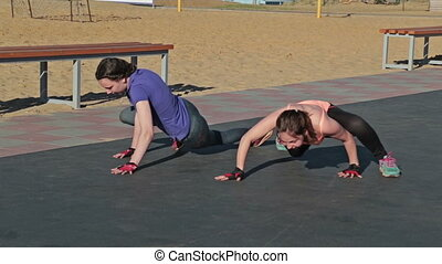 Girls start exersice crawing on the ground, crossfit