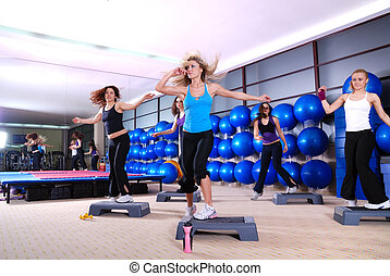 girls stepping in a fitness center - group of girls stepping...