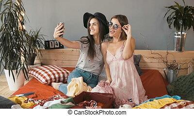 Girls Take Selfie while Packing