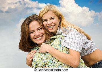 girls together against sky